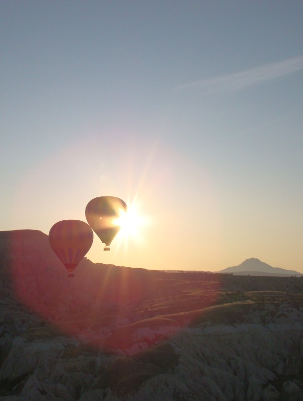 Drifting effortlessly in the hot air balloon over the spectaculat landscape of Cappadocia