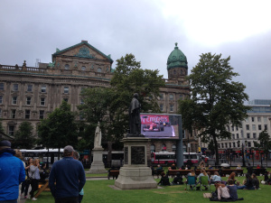 The big screen outside Belfast City Hall, with a crowd beginning to gather ahead of Belfast Pride's screening of 'Mamma Mia'